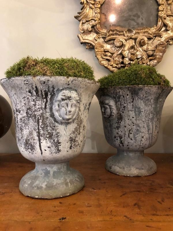 Pair of cast iron enamel urns 19 th c