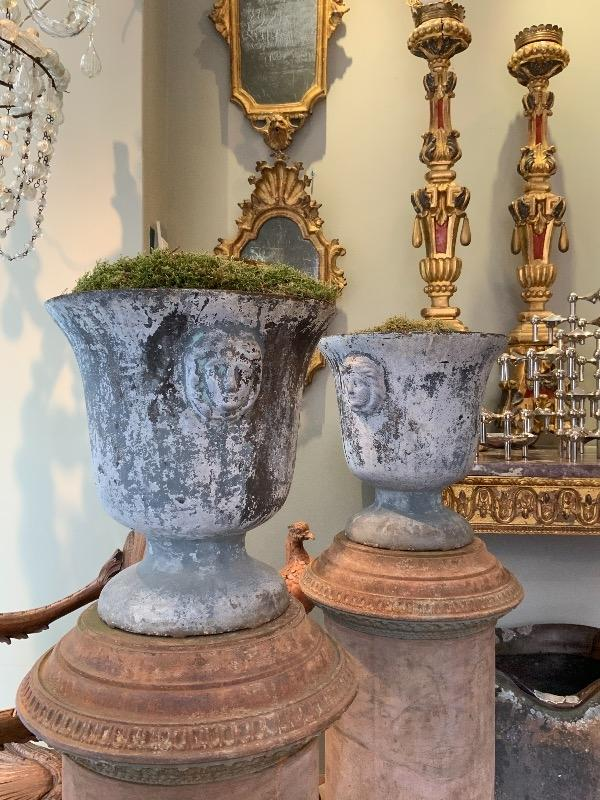Pair of cast iron enameled  urns XIX th c