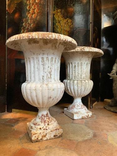 Pair of cast iron urns circa 1900