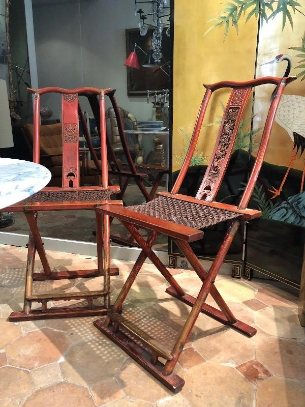 Pair of Chinese red lacquered folding chairs circa 1900