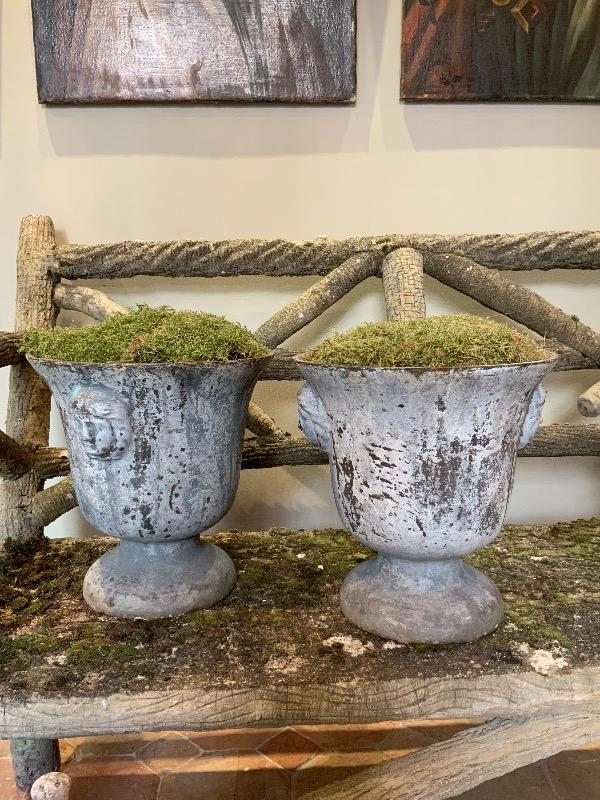 Pair of enamel cast iron urns XIX th c