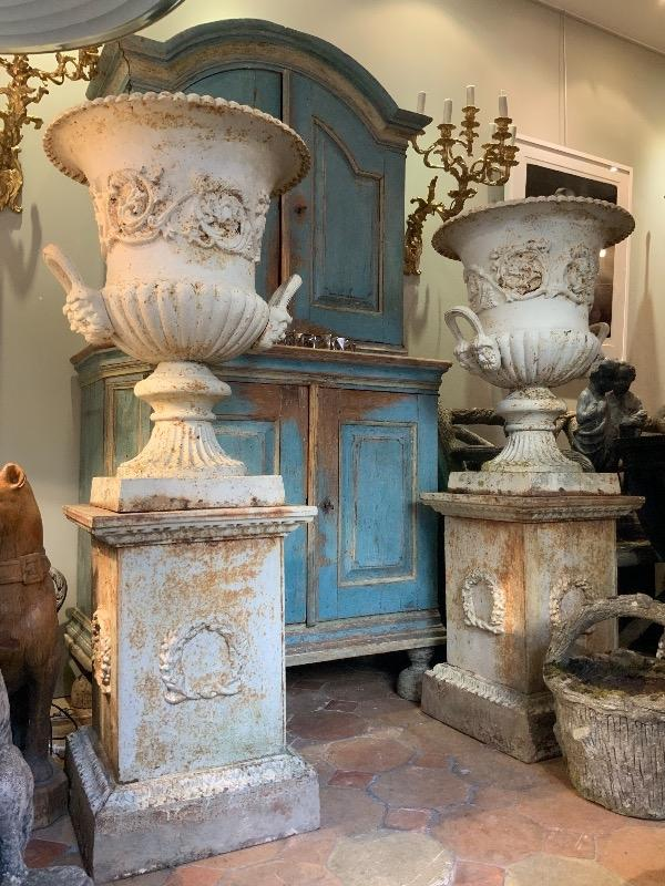 Tall pair of English urns on plinths England circa 1900